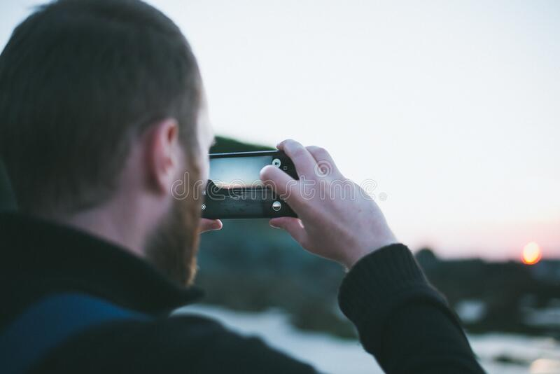 Snapping photos with smartphone royalty free stock photo