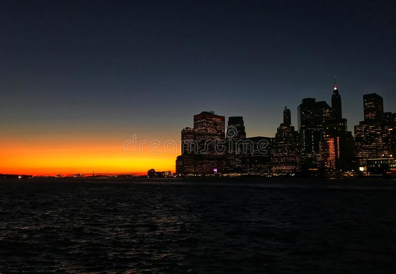 Manhattan skyline in the sunset. A snapshot of the Manhattan skyline during sunset from Brooklyn stock image