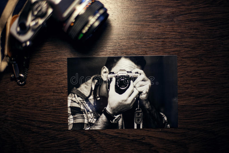 Snapshot of photographer with camera royalty free stock image
