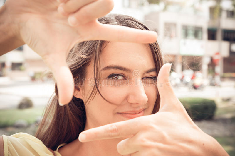 Snapshot. Portrait of woman with snapshot gesture stock photo