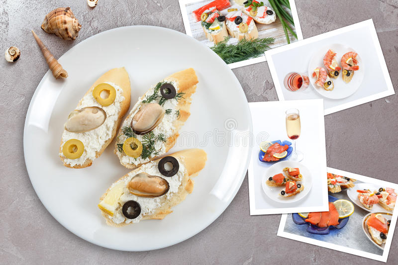 Snapshots of various sandwiches with seafood arranged on rustic wooden background with plates with food and seashells royalty free stock photography