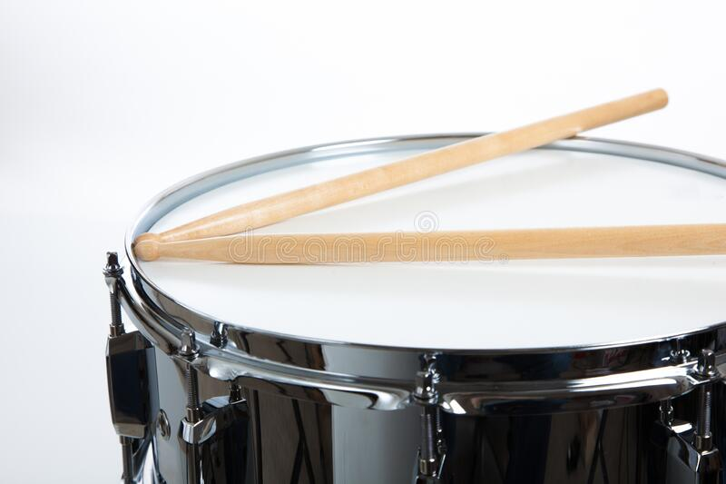 A snare drum with drumsticks on white background royalty free stock photo