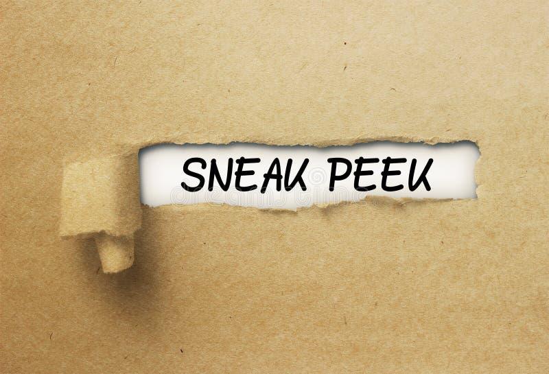 Sneak Peek behind ripped curl paper. Sneak Peek preview behind ripped curl paper stock photo