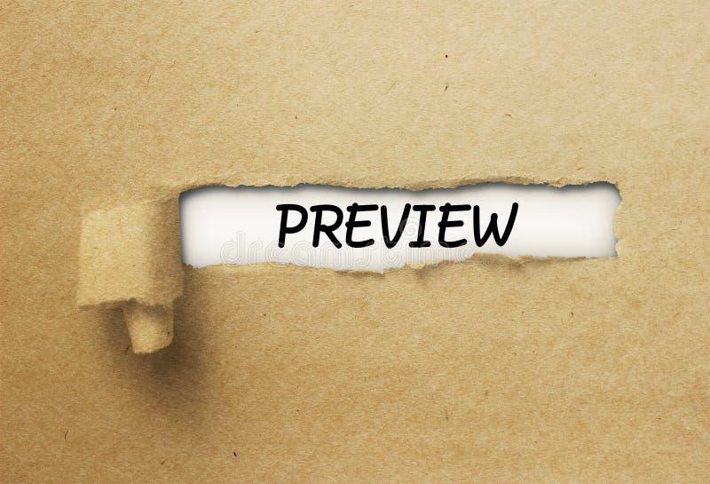 Sneak Peek behind ripped curl paper. Sneak Peek preview behind ripped curl paper royalty free stock photography