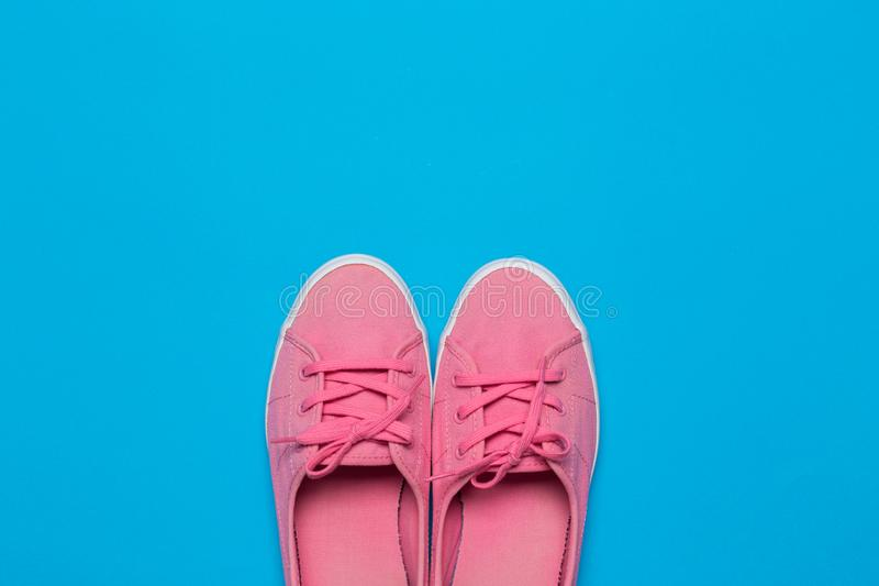 Sneakers on blue background. Fashion blog or magazine concept. Sneakers on blue background. magazine concept stock photo