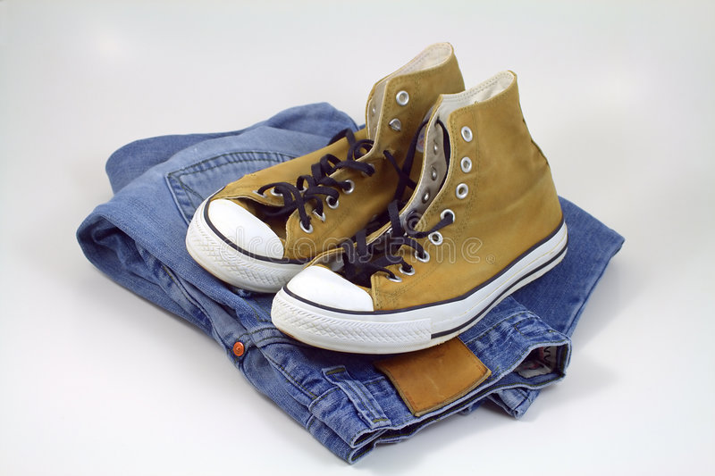 Sneakers and jeans stock photography