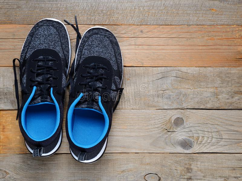 Sneakers on wooden background royalty free stock image
