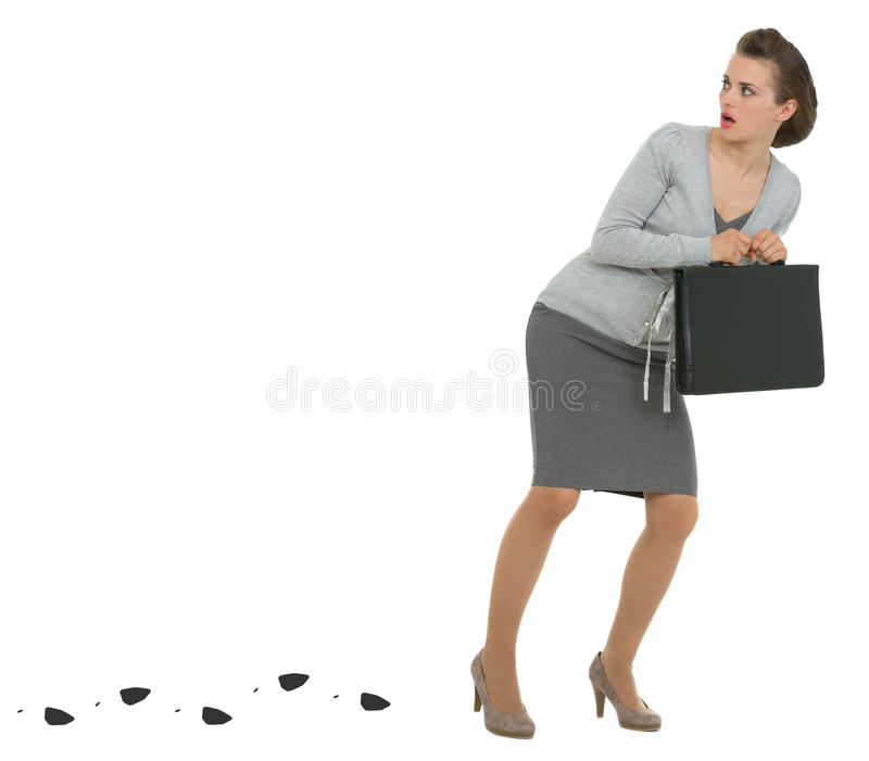 Sneaking Business Woman Leaving Trace Royalty Free Stock Photo