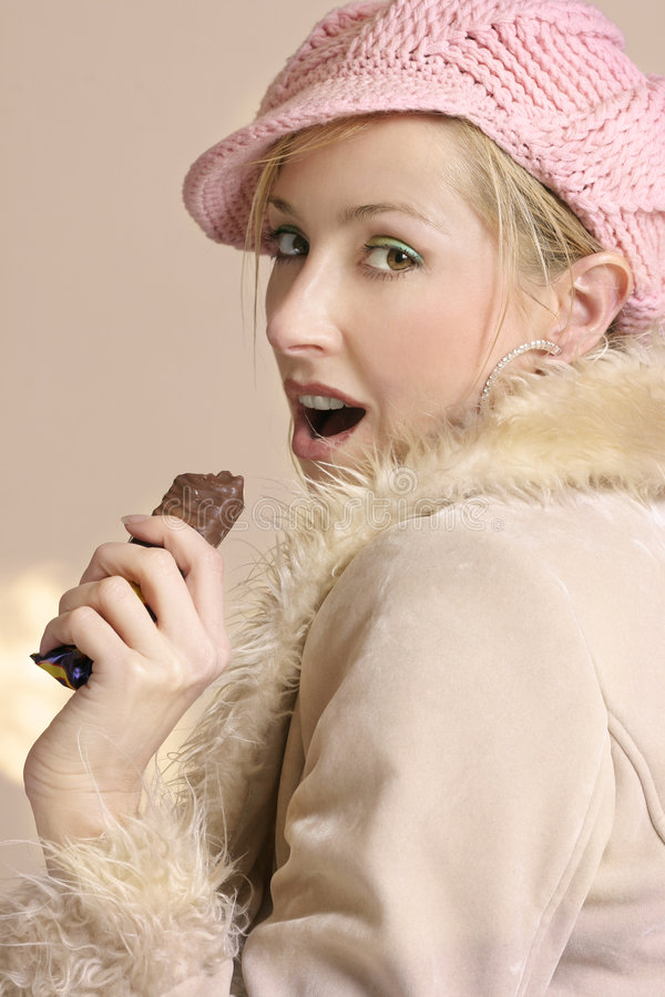 Download Sneaking on her diet stock photo. Image of chocolates, coat - 62866