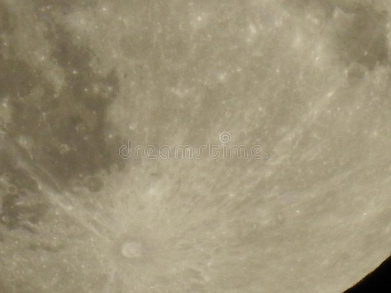 Sneaky Moon or Spy Satellite. Moon spying at night. Photograph of Our Lunar Satellite at Night, as if we were watching stock images