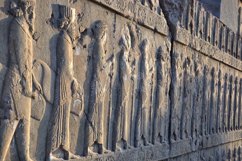 Sned perser på stenväggen i Persepolis royaltyfria foton