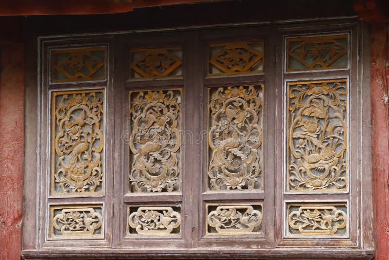 Sned tr?f?nster i den forntida staden av Lijiang, Yunnan, Kina arkivfoton