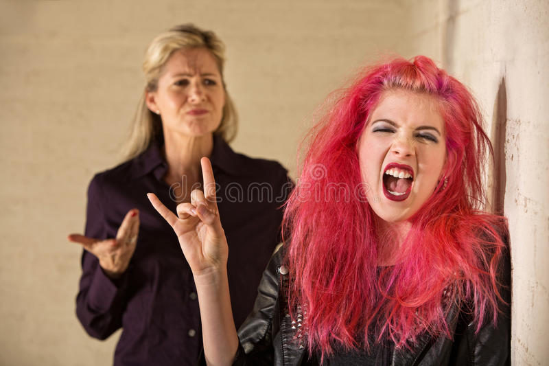 Sneering Parent and Loud Daughter stock images
