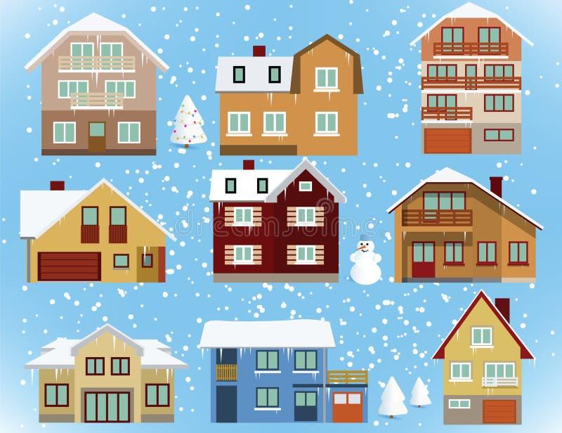 Sneeuw behandelde stadshuizen royalty-vrije illustratie