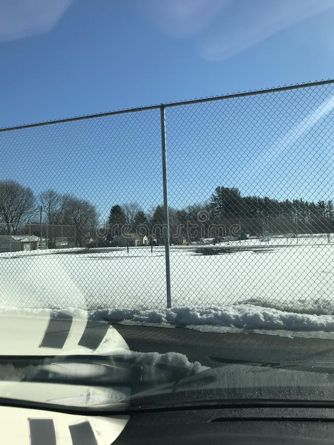 Sneeuw op Tennis stock afbeeldingen