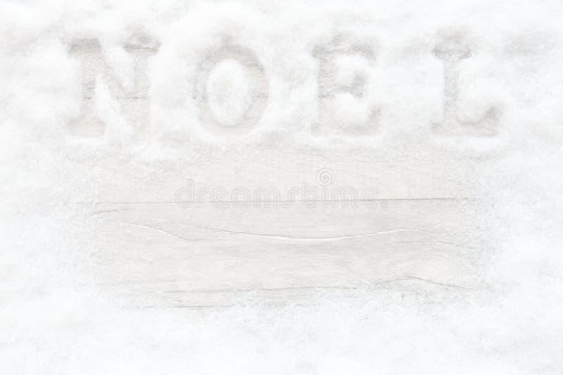 Sneeuwkader met Noel Writing op Gray Wood Texture royalty-vrije stock foto's