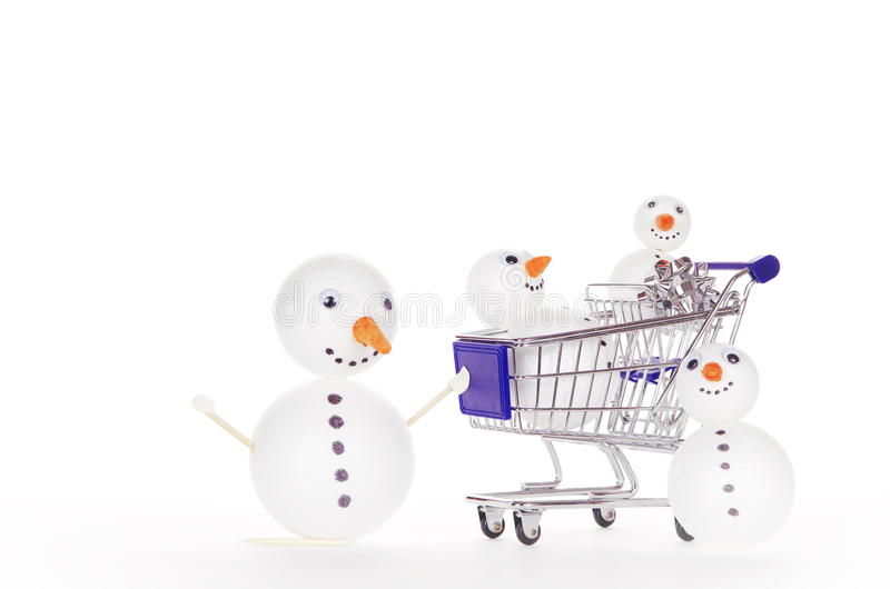 Sneeuwmanboodschappenwagentje stock afbeelding