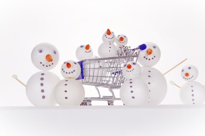 Sneeuwmanboodschappenwagentje royalty-vrije stock afbeeldingen