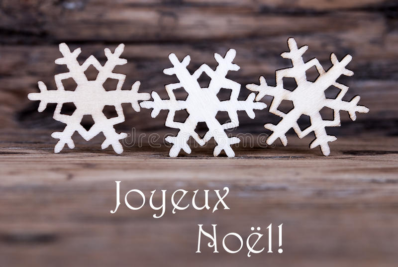 Sneeuwvlokken met Joyeux Noel royalty-vrije stock foto's