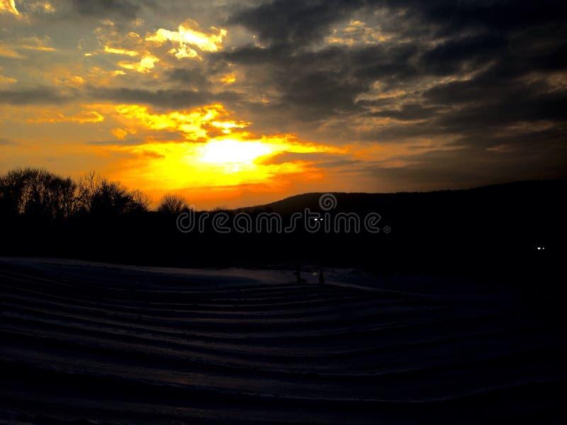 Sneeuwzonsondergang royalty-vrije stock fotografie