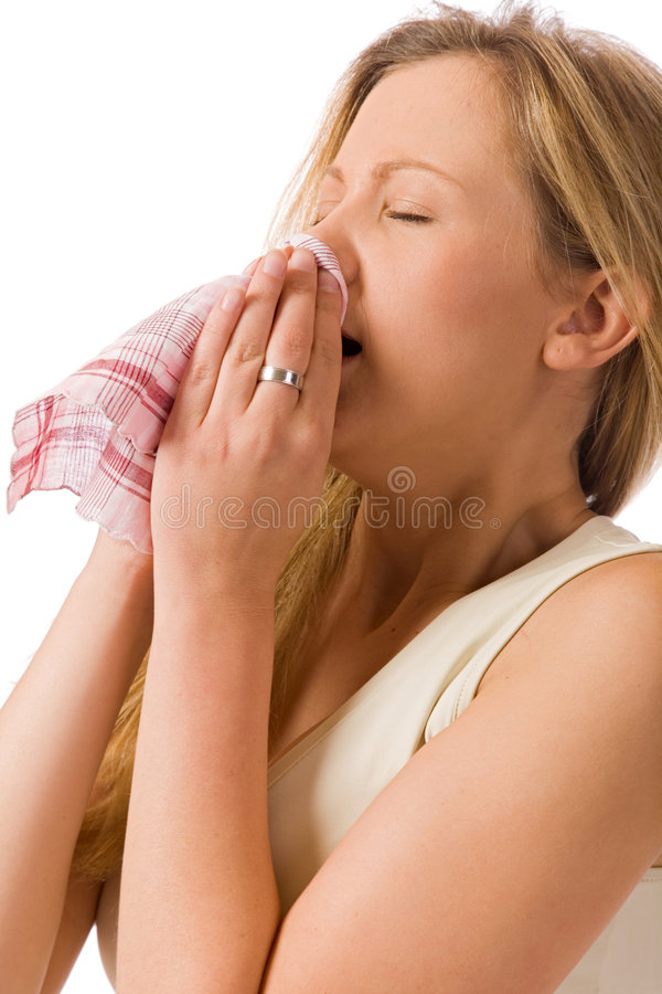 Sneeze. Blond girl with hay fever isolated on white background