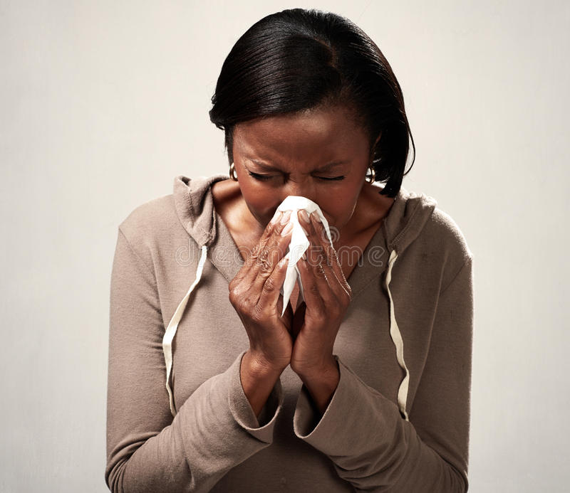 Sneezing black woman royalty free stock image