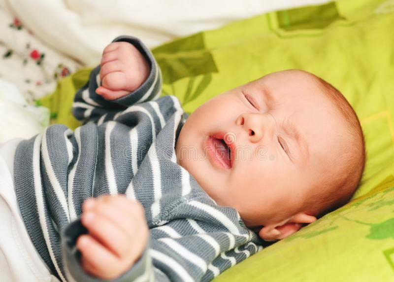 Sneezing newborn baby royalty free stock photos