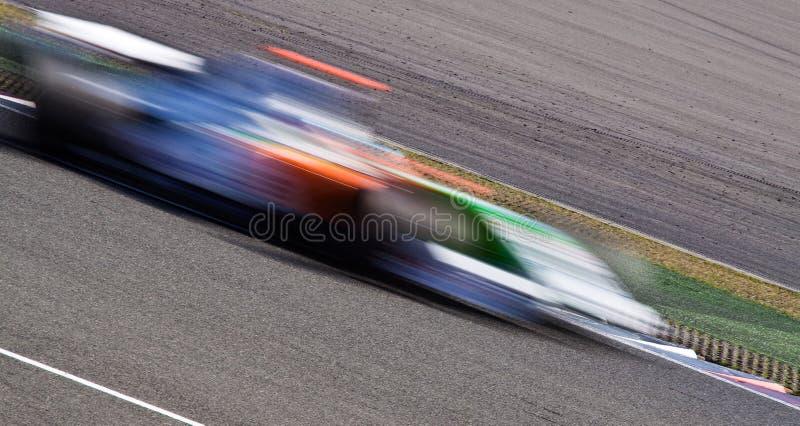 Snel raceautoonduidelijk beeld stock foto