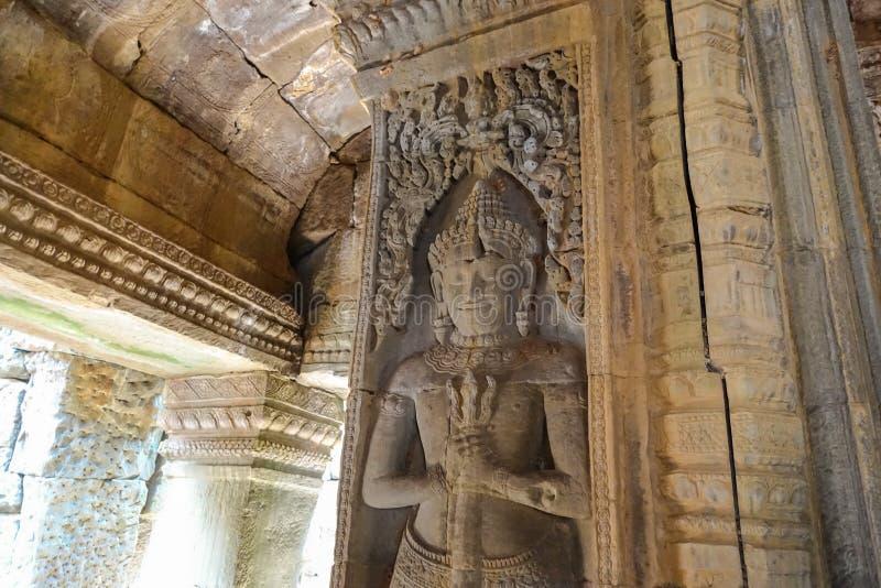 Snidit av väggen av den Bayon templet på Angkor Thom royaltyfri foto