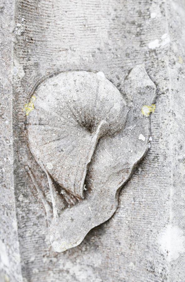 Snigel som snidas i sten royaltyfria bilder