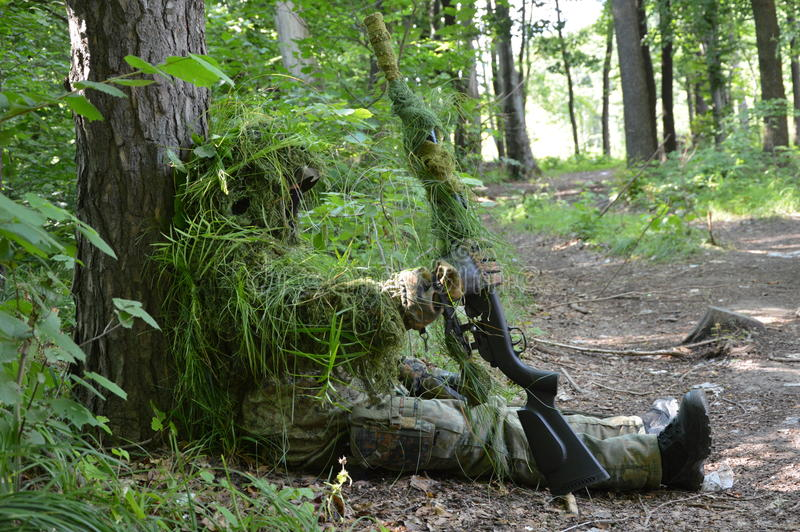 Sniper in the forest royalty free stock photos