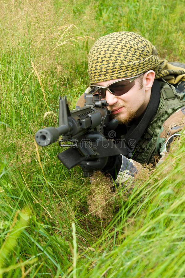 Sniper Laying In A Grass Stock Images