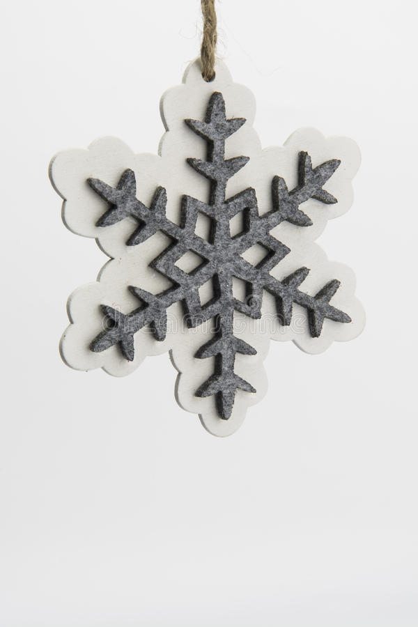 Snoewflake Christmas decoration. Xmas decoration felt and wood grey and whits stock photos
