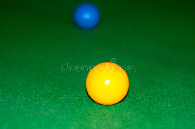Yellow and blue balls of the snooker stock images