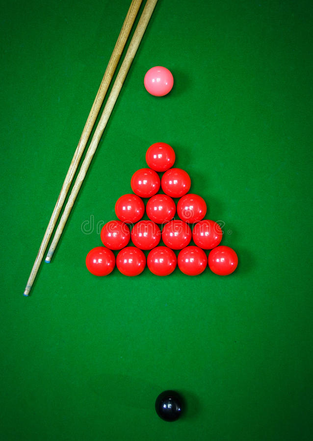 Snooker balls set on a green table stock photography