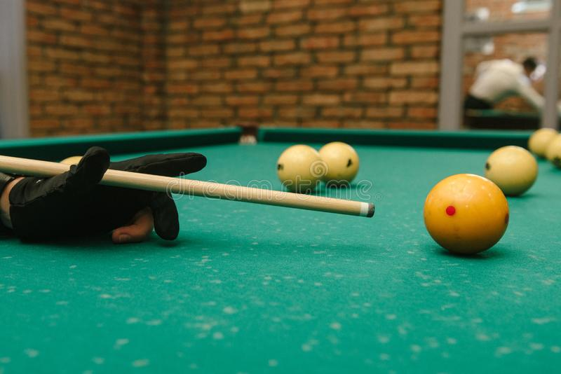 Snooker. close-up . male hands with cue playing billiards stock photo