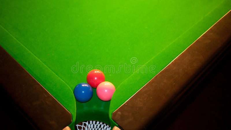 Snooker table with three balls in the corner royalty free stock image