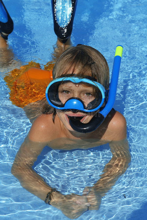Snorkel and mask. Child playing with snorkel mask flippers royalty free stock photo