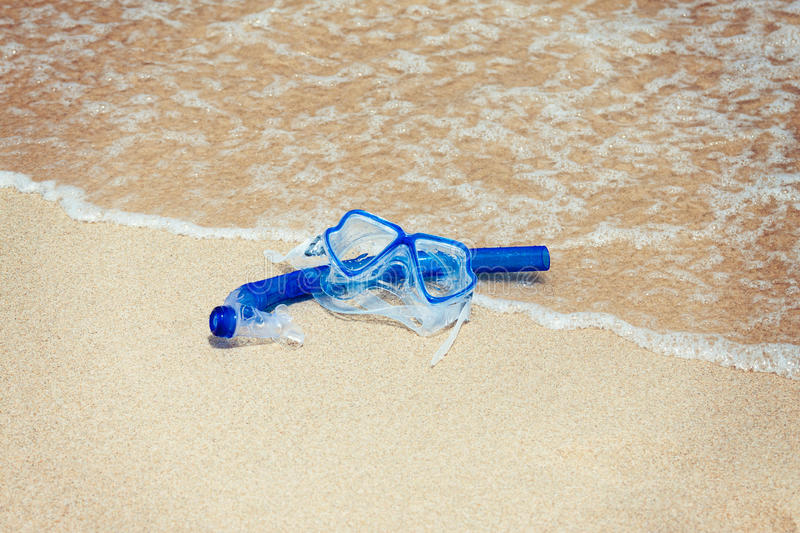 Snorkel mask on the beach royalty free stock photos