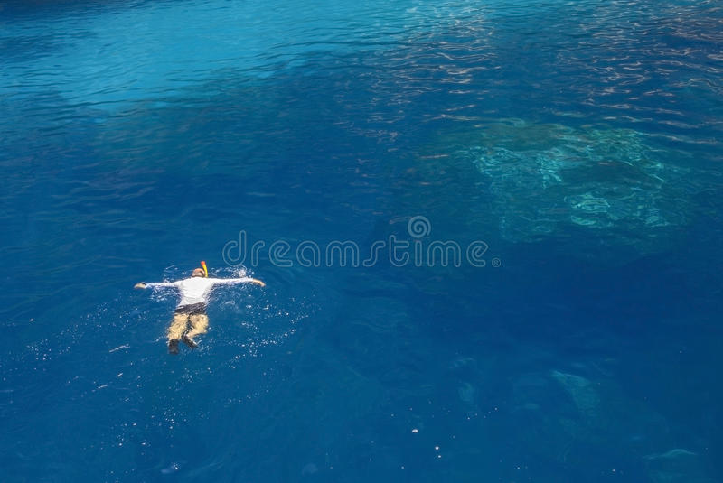 Snorkeler in turquoise water royalty free stock photo
