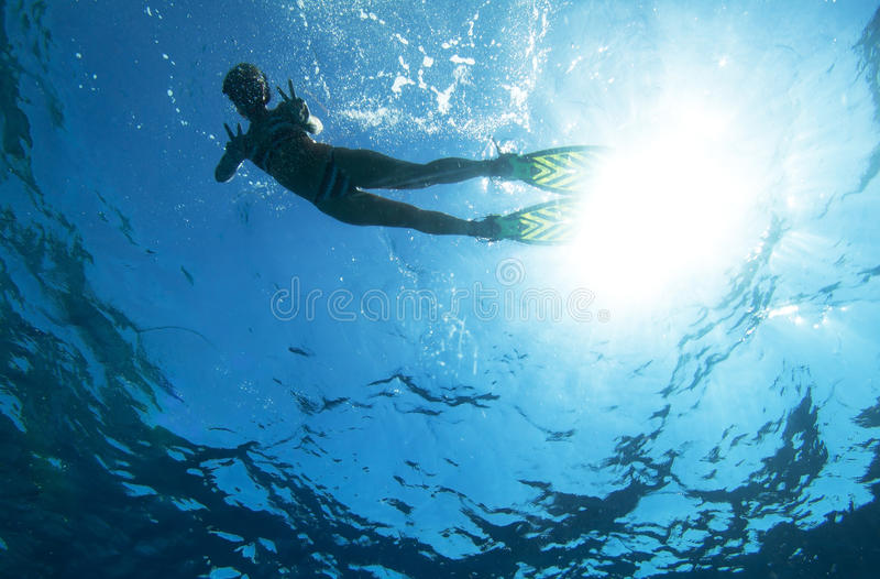 Snorkeling. Woman snorkeling in blue water royalty free stock photography