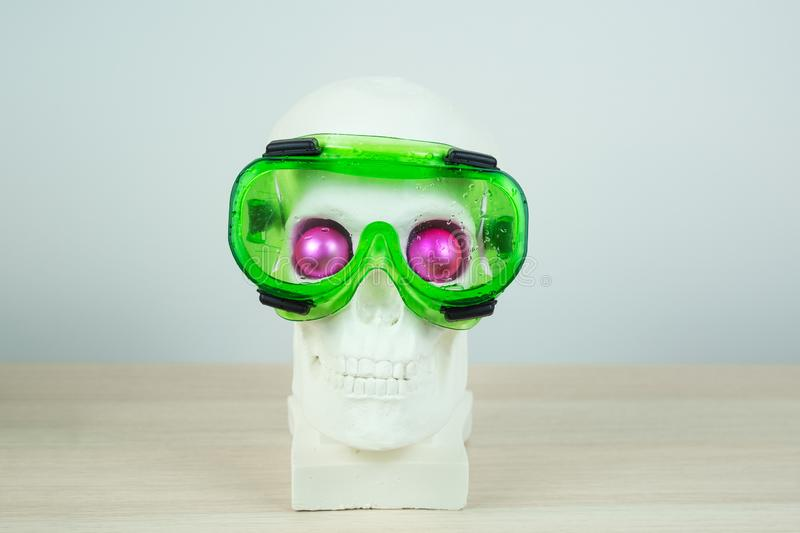 Snorkeling scuba diving skull sculpture with pink eyes with mask.  royalty free stock images
