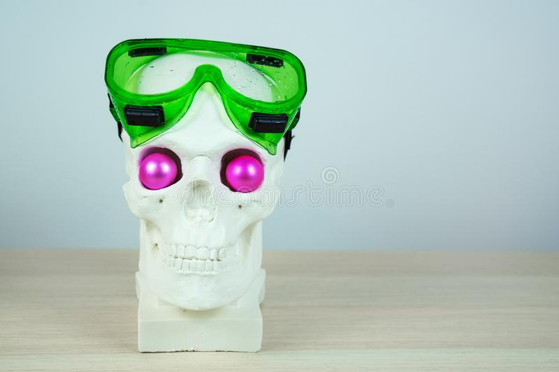 Snorkeling scuba diving skull sculpture with pink eyes with mask.  royalty free stock photos