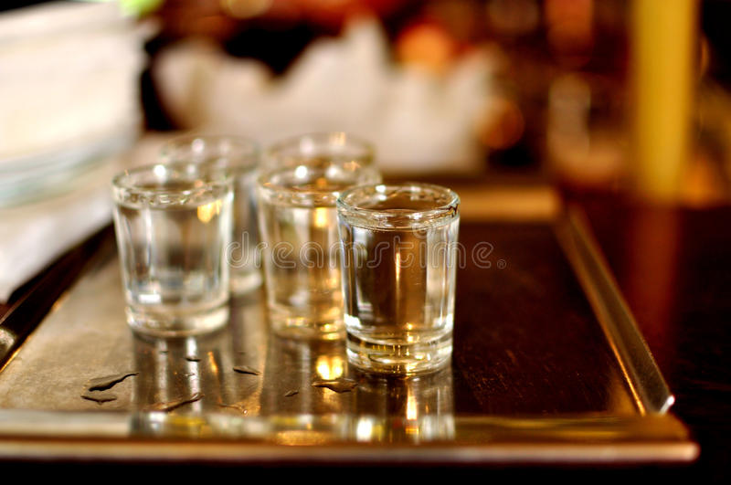 Snorters of plum brandy on plate royalty free stock images