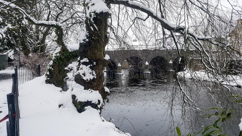 Ireland. Kanturk. Winter in County Cork. Snow along the banks of the River Dalua near the old bridge during storm Emma in March 3, 2018 stock photo