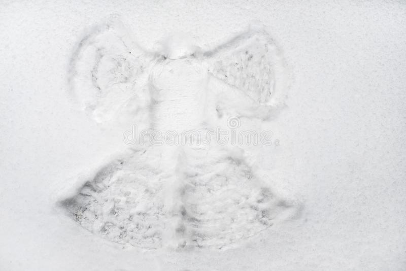 Snow angel made in the white snow royalty free stock photo