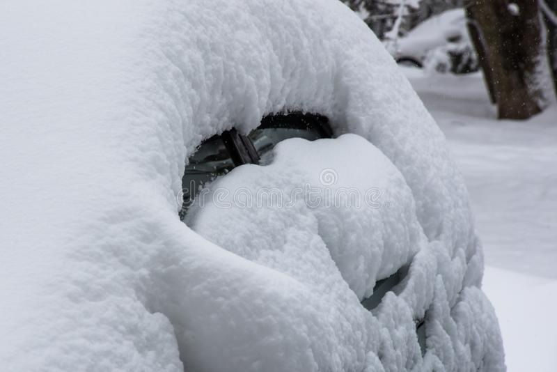 Snow anomaly, snow-covered cars royalty free stock photo