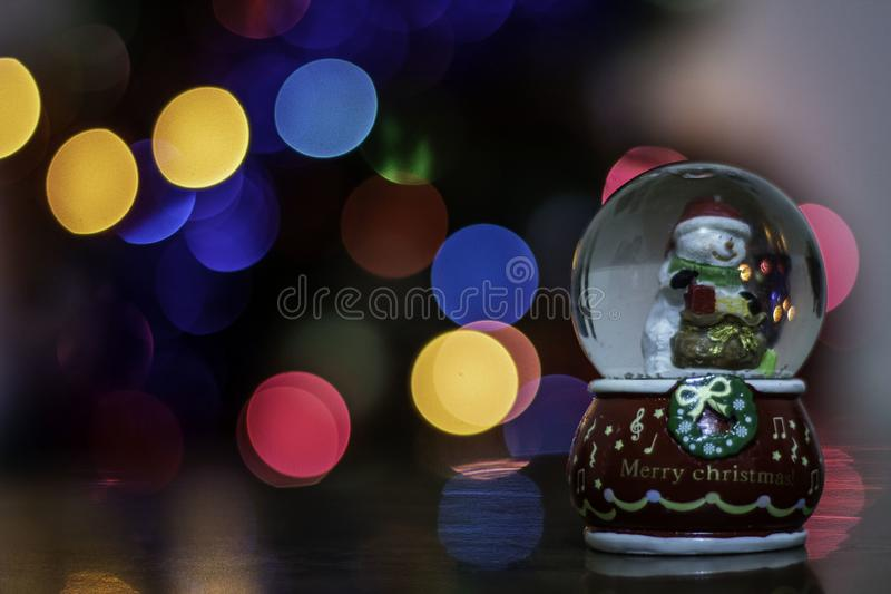 Snow ball in front of Christmas tree stock photography