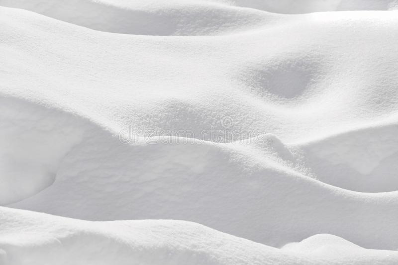 Snow banks, only white, snow texture. Snow banks, all white. Monochromatic picture. Horizontal shoot, outdoor picture. Background. Snow texture. Only white royalty free stock images