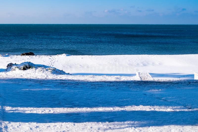 The beach and snow royalty free stock image